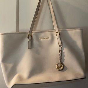 Michael Kors bag comes with duster bag.